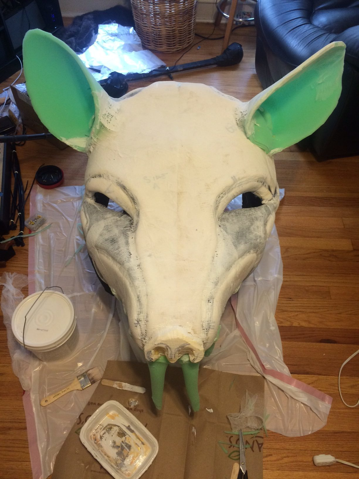 The base is covered in cheesecloth and Sculpt-Or-Coat, and has its teeth and ears added.